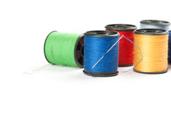Bobbin threads with needle Stock Photography