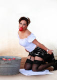 Bobbing for Apples. Beautiful pin up girl bobbing for apples in a retro outfit and make up Stock Image
