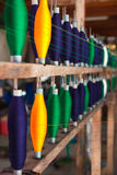 Bobbins. Colorful thread for textile fabric Stock Image
