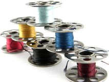 Bobbins. Of vibrantly colored thread isolated on white Royalty Free Stock Photos
