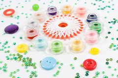 Bobbins, buttons on white. Multicolor sewing bobbin, buttons and beads on white background Stock Photography