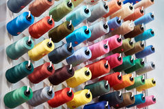 Bobbins with colored thread for industrial textile Stock Photo