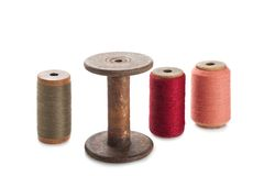 Bobbins and colored threads Stock Photography