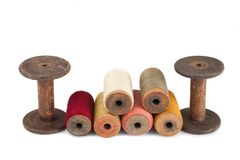 Bobbins and colored threads Stock Photos