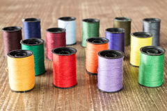 Bobbins with colorful threads Royalty Free Stock Photo