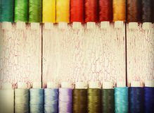 Bobbins with colorful threads Stock Image