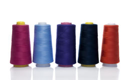 Bobbins with cotton Stock Images