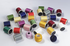 Bobbins of cotton thread for sewing machines and thread skeins Royalty Free Stock Photo