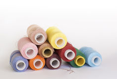 Bobbins of different colored threads Stock Photography