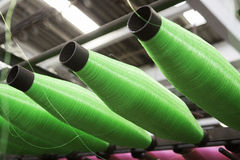 Bobbins with green ropes Royalty Free Stock Photos