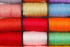 Bobbins of lurex thread Royalty Free Stock Image