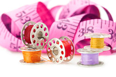 Bobbins and measuring tape Royalty Free Stock Images