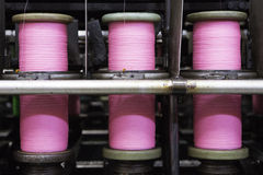 Bobbins with pink rope Royalty Free Stock Photography