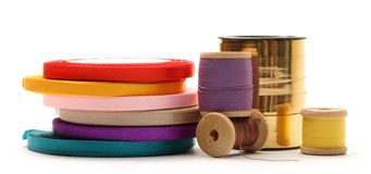 Bobbins and reels of ribbon Stock Photos
