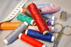 Bobbins tape measure and scissor Stock Photography