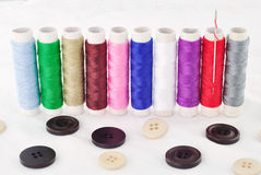 Bobbins of thread And Clasper Royalty Free Stock Photos