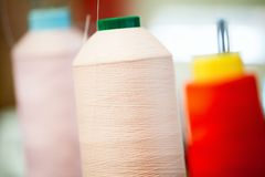 Bobbins with thread for industrial textile machines.  Royalty Free Stock Image