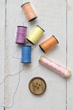 Bobbins with thread on the table Stock Images