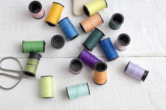 Bobbins with thread on the table Royalty Free Stock Photo
