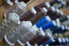 Bobbins of Thread. At a workshop Stock Images