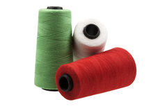 Bobbins with threads Stock Images
