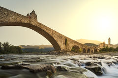 Bobbio's bridge. Hunchback bridge. Bobbio. Emilia-Romagna. Italy. The old bridge Gobbo with its archs over the river at sunset royalty free stock photography