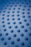 Bobbled blue background. Bobbled blue rubber surface for use as background. Deliberate shallow depth of field Stock Photos