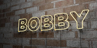 BOBBY - Glowing Neon Sign on stonework wall - 3D rendered royalty free stock illustration. Can be used for online banner ads and direct mailers Stock Images