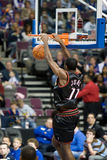 Bobby Jones Dunks. Bobby Jones of the Philadelphia 76ers dunks during a game against the Detroit Pistons at the The Palace Of Auburn hills during the 2006-2007 Royalty Free Stock Image