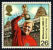 Bobby Moore England World Cup UK Postage Stamp. GREAT BRITAIN - CIRCA 1999: A used postage stamp from the UK, commemorating England winning the 1966 Football Royalty Free Stock Photo