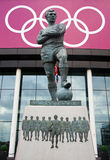 Bobby Moore Statue. The Bobby Moore statue outside 2012 Olympic football venue Wembley Stadium in England.  Moore captained the 1966 England football world cup Royalty Free Stock Photo