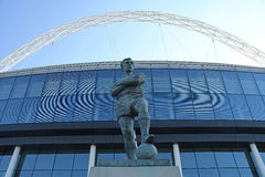 Bobby Moore Statue in front of Wembley Stadium. Bobby Moore's statue pictured in front of Wembley Stadium prior to the 2016/17 UEFA Champions League Group E game stock photography