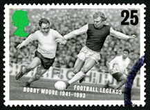 Bobby Moore UK Postage Stamp. GREAT BRITAIN - CIRCA 1996: A used postage stamp from the UK, in honour of footballing legend Sir Bobby Moore, circa 1996 Stock Image