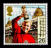 Bobby Moore with World Cup, 1966, Millennium Series 6 - The Entertainers` Tale serie, circa 1999. MOSCOW, RUSSIA - OCTOBER 3, 2017: A stamp printed in Great stock images