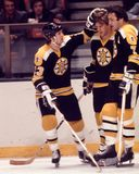Bobby Orr and Phil Esposito, Boston Bruins. Boston Bruins Hall of Fame defenseman Bobby Orr and forward Phil Esposito celebrate a goal. Image taken from a color Stock Image