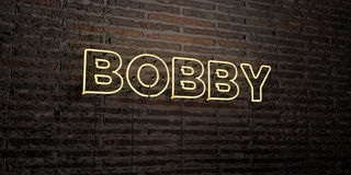 BOBBY -Realistic Neon Sign on Brick Wall background - 3D rendered royalty free stock image. Can be used for online banner ads and direct mailers Royalty Free Stock Photo