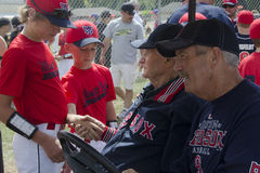 Bobby Shakes Hands. JUNCTION CITY, OREGON – JUNE 22, 2013 – Baseball Hall of Fame Red Sock second baseman Bobby Doerr shakes hands with fans at the annual Stock Image
