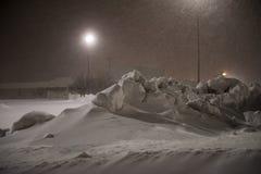 Bobcat die sneeuw verwijdert Stock Foto