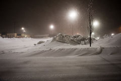 Bobcat die sneeuw verwijdert Stock Foto's