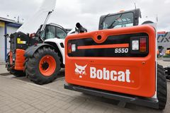 Bobcat heavy duty equipment vehicle and logo Royalty Free Stock Photography