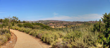 Bobcat Hiking Trail in Newport Beach. Green plants and dirt path of Bobcat Hiking Trail in Newport Beach, California in spring royalty free stock photos