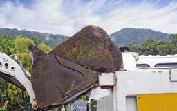 Bobcat moving boulders Stock Image