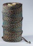 Bobina de la cuerda en el fondo blanco Fotos de archivo libres de regalías