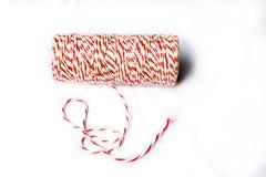 Bobina della cordicella del panettiere rosso e bianco Fotografie Stock
