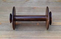 Bobina di legno vuota della ruota di filatura Fotografia Stock