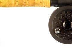 Bobina parziale della mosca e di Cork Fishing Rod Handle su bianco Fotografia Stock