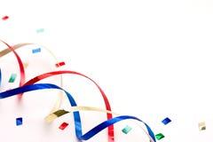 Bobinadores de cintas en modo continuo y confeti coloridos Imagen de archivo
