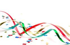 Bobinadores de cintas en modo continuo y confeti del día de fiesta Fotografía de archivo libre de regalías