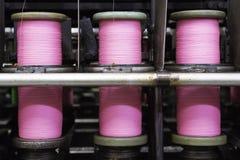 Bobinas con la cuerda rosada Fotografía de archivo libre de regalías