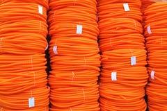 Bobine arancio del tubo flessibile Fotografie Stock
